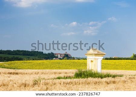 God's torture with sunflower field and Jaroslavice Castle, Czech Republic - stock photo