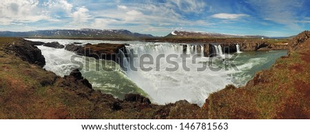 Godafoss waterfalls with mountain in Iceland - stock photo