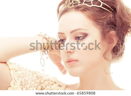 Goddess in a diadem and bracelets of gold, isolated on white background. - stock photo