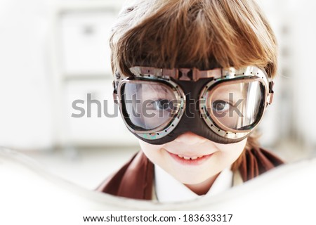 Goggles boy dreams of becoming a pilot - stock photo