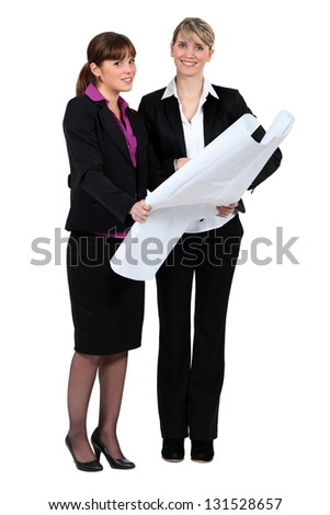 Going over the plans. - stock photo