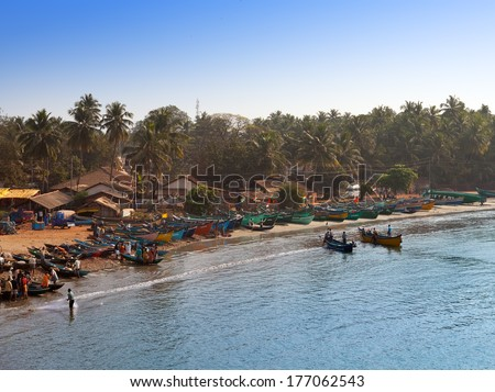 GOKARNA, INDIA - JANUARY 31: fishing boats in a bay in the Gokarna on January 31, 2014 in Karnataka, India.   - stock photo