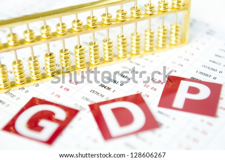 Gold abacus and statistical report - stock photo