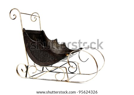 Gold and brown Christmas sleigh isolated on white background - stock photo