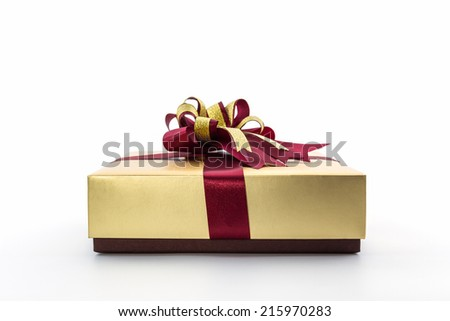 Gold and brown gift box with ribbon bow on white background.  - stock photo