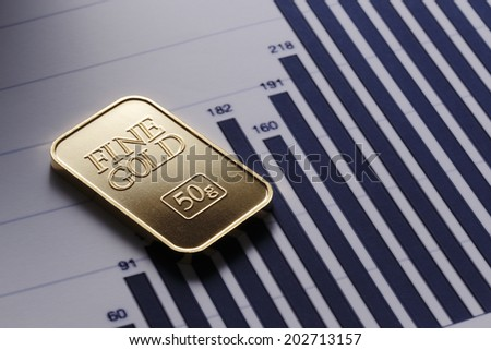 Gold and graph - stock photo