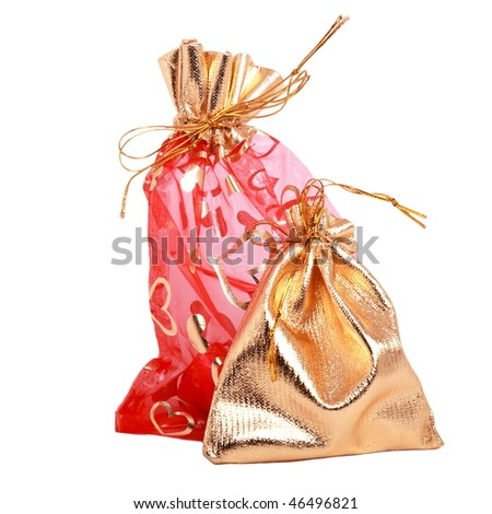 Gold and red gift bags isolated on white - stock photo