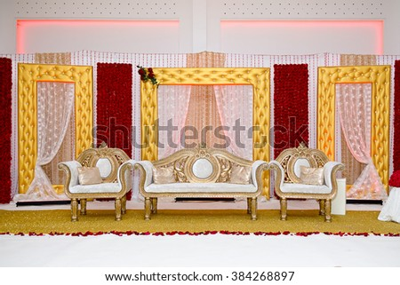 gold and red themed wedding stage - stock photo