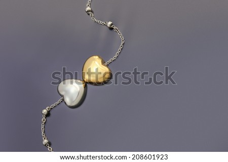 Gold and Silver Heart necklace - stock photo