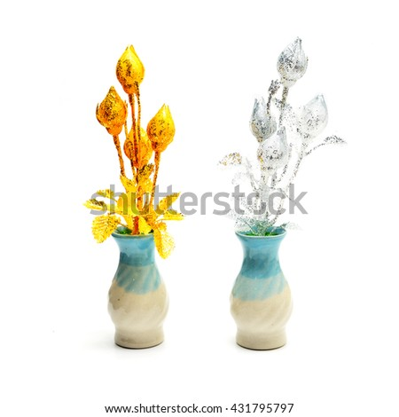 Gold and silver lotus  fake flower for offerings Buddha on white background. - stock photo