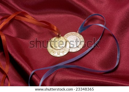 Gold and silver medals on red - stock photo