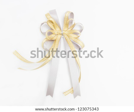 Gold and silver ribbon on white background. - stock photo