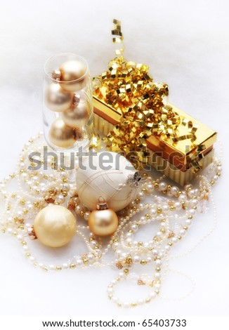 Gold and white present, ornaments and garland - stock photo