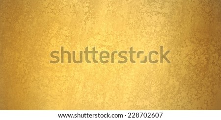 gold background banner, texture is old vintage distressed solid gold color with rough peeling paint - stock photo