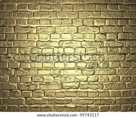 Gold background. Brick wall. - stock photo