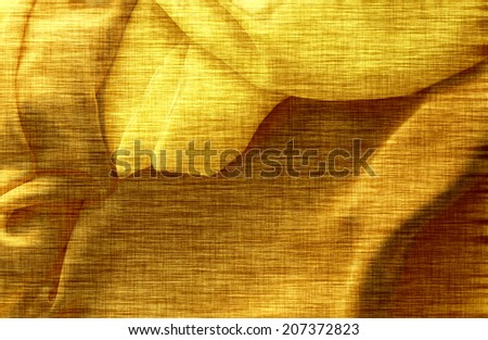 Gold background, linen texture, bright festive backdrop for advertisement, wrapping paper, label, greeting card, scrapbook, wedding invitation etc - stock photo