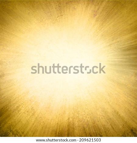 gold background, yellow streaks of light radiate from center to dark brown frame in sunburst pattern  - stock photo