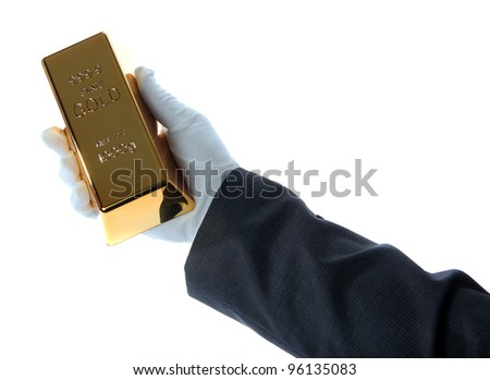 gold bar in hand of a business man - stock photo