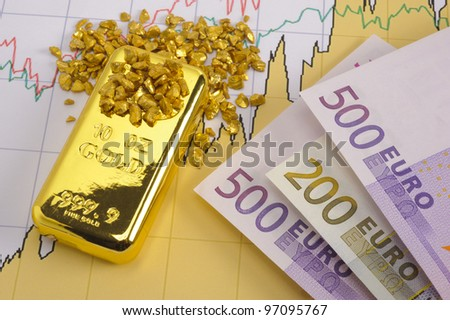 gold bar, nuggets and euro banknotes on financial chart - stock photo