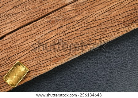 Gold bar put on the hard wood brown color surface background represent the business and investment concept idea. - stock photo