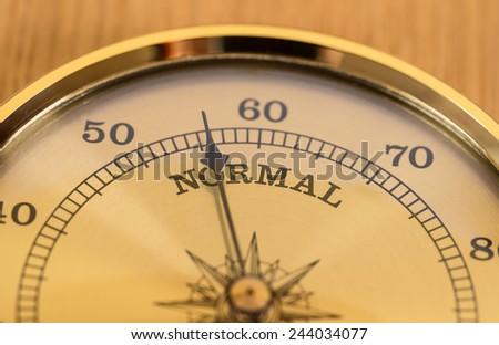 Gold Barometer indicating atmospheric pressure reduction - stock photo