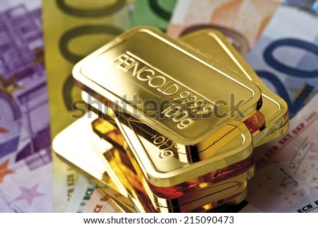 Gold bars and Euro bank notes - stock photo