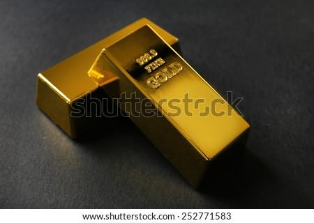 Gold bars on black background - stock photo