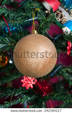 Gold bauble on Christmas tree - ball - stock photo