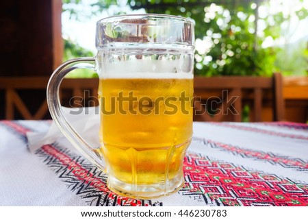 Gold beer with froth on top. Draft cold beer in glass jars in pub hotel or restaurant. Still life. - stock photo