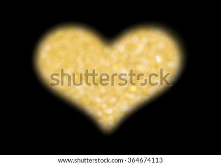 gold bokeh light as love heart shape on black background - stock photo