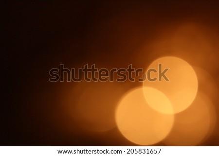 Gold bokeh on black background - stock photo