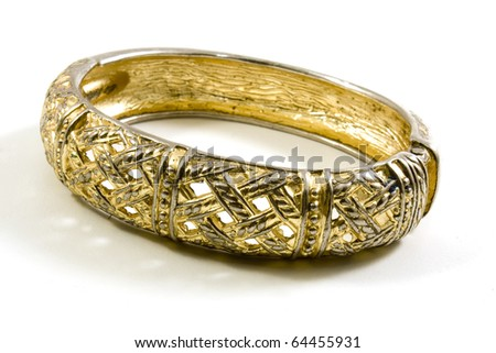 gold bracelet on white background - stock photo