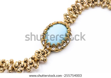 gold bracelet with blue stone on a white background - stock photo
