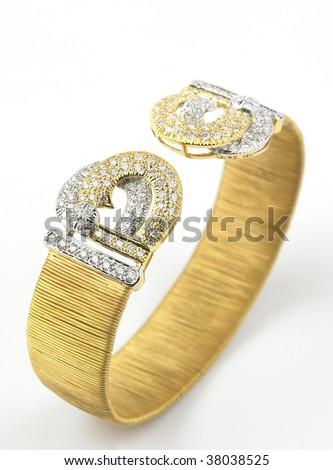 gold bracelet with diamonds - stock photo