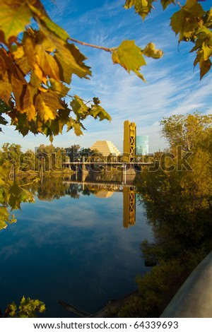 Gold Bridge framed by autumn leaves - stock photo
