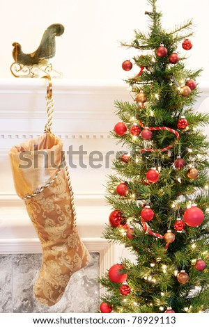 Gold brocade stocking hanging on the mantelpiece - stock photo