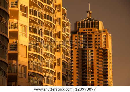 Gold building with sunset light. - stock photo