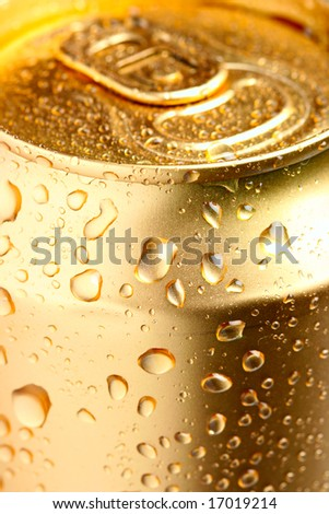 Gold can of drink with water drops close-up - stock photo