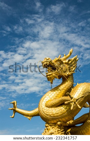 Gold chinese dragon of thailand on blue background. - stock photo