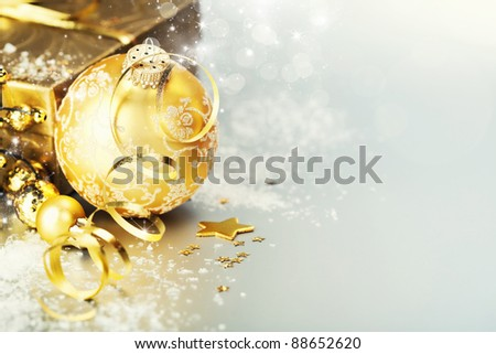 Gold christmas ball with gift box - stock photo