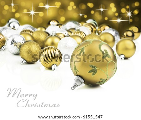 Gold christmas decorations on a white background with space for text - stock photo
