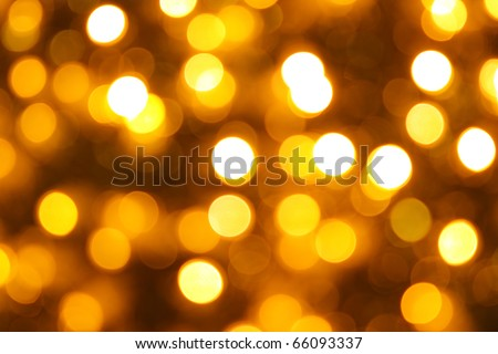 Gold christmas lights background. Abstract blurred light background. Blur bokeh - stock photo