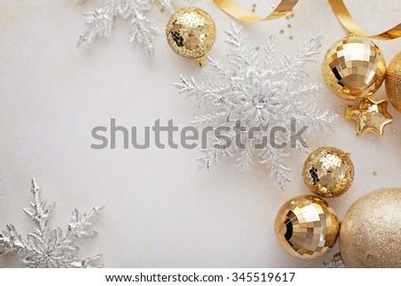 gold christmas ornaments frame background , seasonal decoration - stock photo