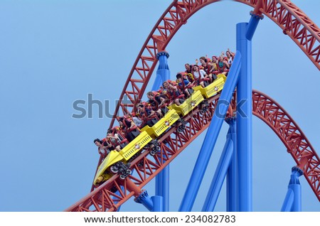 GOLD COAST, AUS -  NOV 06 2014:Visitors ride on Superman Escape in Movie World Gold Coast Queensland Australia.It's an Accelerator Coaster that accelerates from 0 to 100 Km per hour (62 mph) in 2 sec. - stock photo
