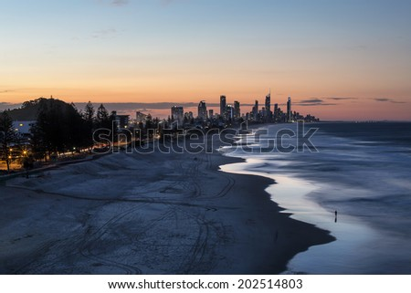 Gold Coast cityscape and famous beach sunset from Miami Headlands - stock photo