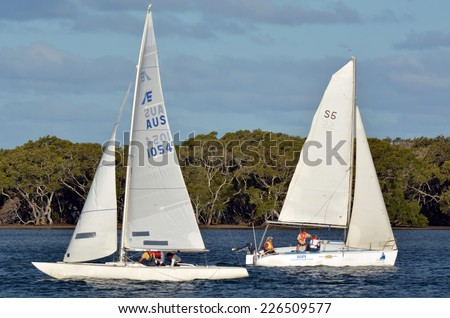 GOLD COAST- OCT 22 2014:Australian people sail yachts. With 9 times more waterways than Venice, the Gold Coast is a boating paradise with over 260 kilometers of navigable waterways within the city. - stock photo