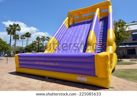 GOLD COAST - OCT 19 2014:Big slide bouncy Castle..In 2001 U.S. Consumer Product Safety Commission outline the dangers and recommended safety precautions for operating an inflatable structure. - stock photo