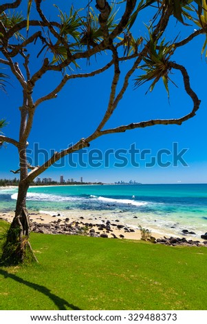 Gold Coast skyline and surfing beach visible from Burleigh Heads, Queensland - stock photo