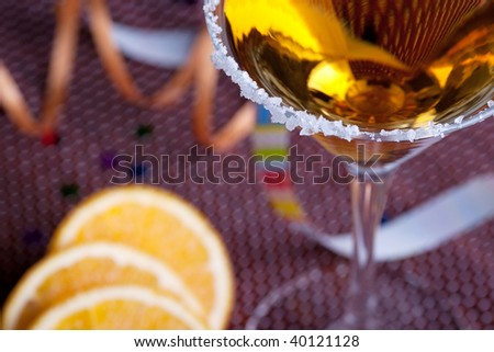 Gold cocktail in martini glass with salt on the rim - stock photo
