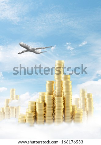 gold coins city and airplane in sky - stock photo
